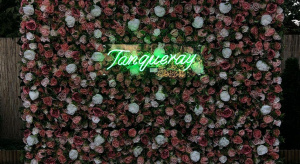 Tanqueray neon on flower wall